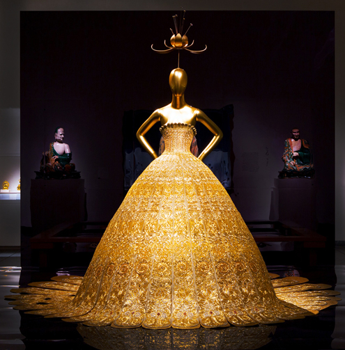 No stranger to brocade. Guo Pei's gold lame, silk, and silver showstopper enchanted museum goers at last year's China: Through the Looking Glass exhibit. Is Guo Pei's hand embroidered gown better, more precious than Lagerfeld's scuba confection?