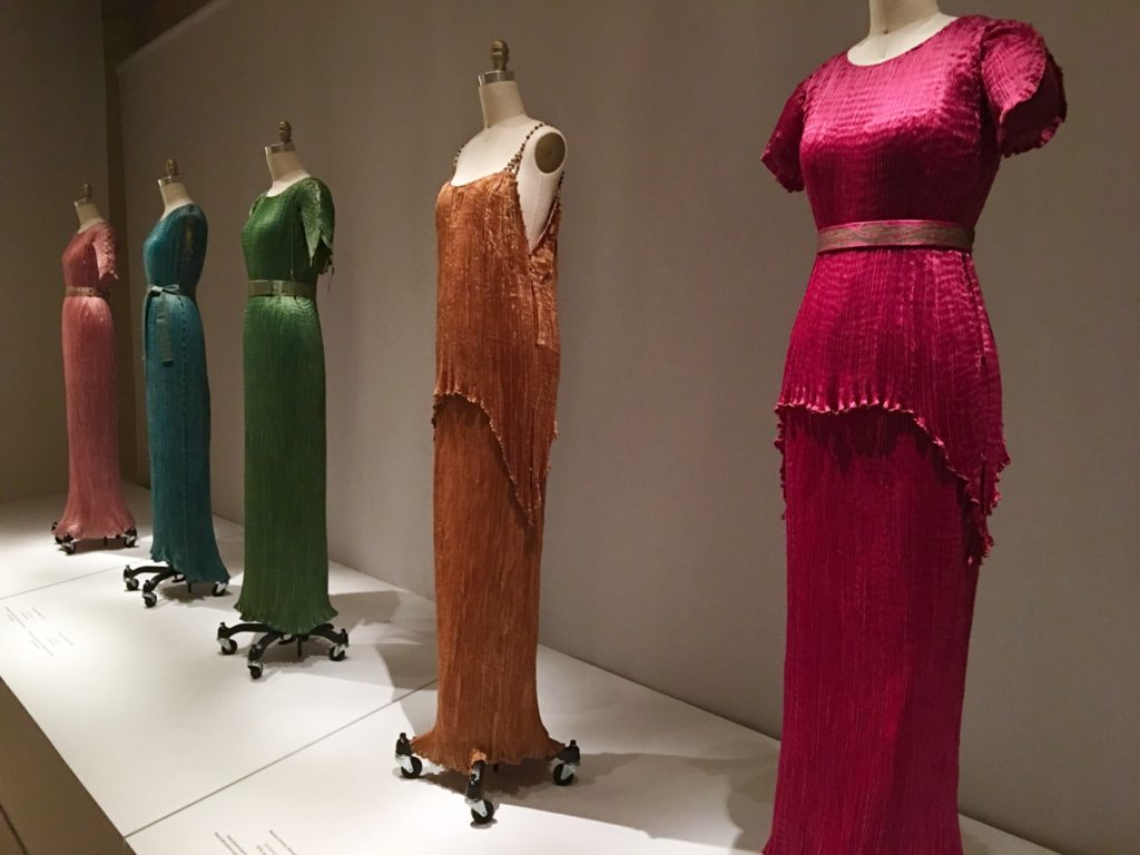 An array of Mariano Fortuny's silk gowns, most notably the classic Delphos gown. Photo Credit- Mallory O'Donoghue.